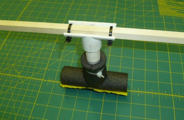 And finally, zip tie it around whatever arm you have. I like to mark the pipe at the top of the foam T with a black marker pen so I can see if its compressed after one of my so-called landings. It helps me to quickly level the airframe again.