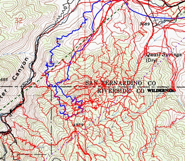 A close up of the southeastern slopes of the mouth of Smith Water Canyon with JT49 in blue, original search tracks in black, searching since then in red, the Serin cell tower 10.6 mile radius in dashed green and the Serin 11.1 mile radius in dotted purple.