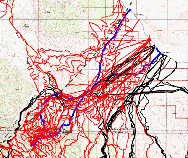 JT51 tracks in blue, original search tracks in black, tracks since in red and Serin cell tower 10.6 mile radius in dashed green.
