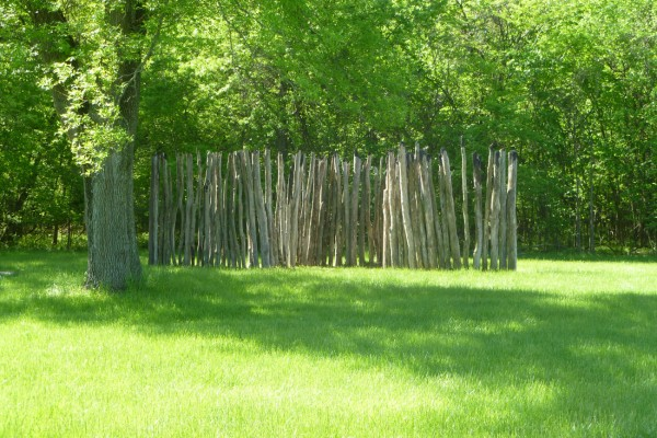 "A reconstructed portion of the 2 1/2 mile pole wall that once surrounded the main area of Cahokia. They must have wanted security from someone as it was rebuilt 4 times and incorporated ""ramparts"" pushing out every 85' or so to allow bowsmen to fire on attackers."