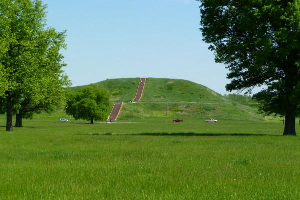On approach to the main mound, Monk's Mound. The people on the upper stairs give a sense of scale. The cars are traveling on a four lane highway that cuts past the base of the mound, a very weird sight.