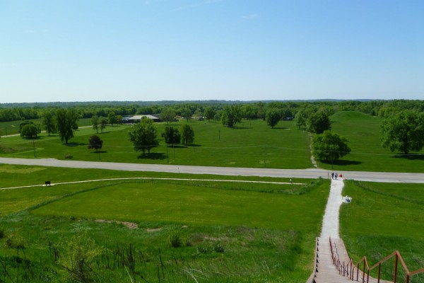 Looking back at the visitor center from the top of Monk's Mound. The visitor center is 0.4 miles away. One of the Twin Mounds is visible to the right, due south. All that green open space is part of the site.