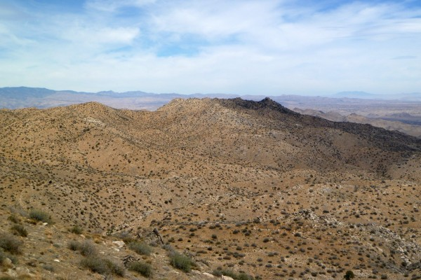 Looking toward Smith Water Canyon from Quail Mountain ridge. The ridge is the southerly rim of Smith Water Canyon. The camera is slightly zoomed to approximate what the view is to a typical human eyeball. This is pretty much what it looks like in real life.