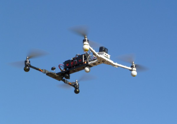 Another view of the Folder in flight. The small forward FPV camera is visible below and to the left of the HD recording camera. The 5.8 GHz circularly polarized antenna is the black mushroom at the rear.