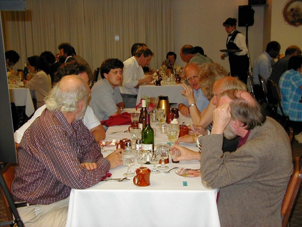 "The ""A"" table where I somehow ended up. On the right that's Kip Thorne, then Wheeler, then Carolee (Kip's wife) and Rai Weiss (brilliant scientist and great guy). On the left is Barry Barrish, director of the entire LIGO project, Dave Ottaway (ner'do'well Australian), my seat and Bill Butler (equally ner'do'well, not Australian but looking quite glassy-eyed)"