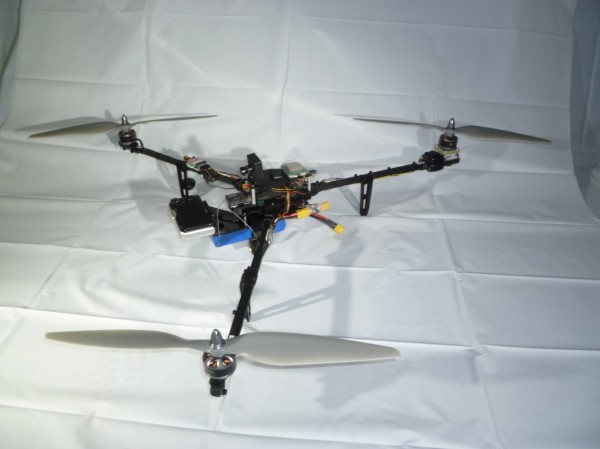 The slightly modified Titan tricopter with the heavy Canon SX230 on the front.