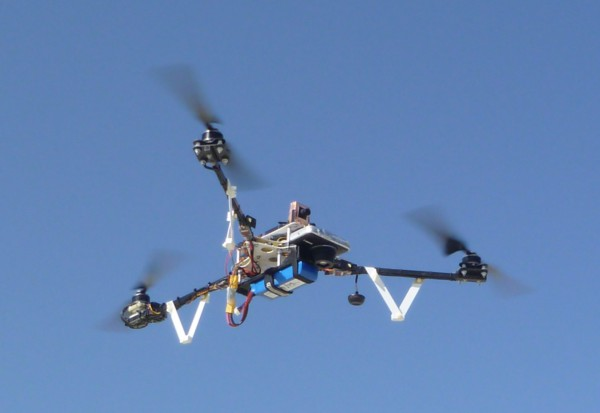 The Tri^2 in flight. The copper wrapped box on the top right is the FPV camera. I wrapped it in a ground plane so it wouldn't mess with the tricopter's GPS reception. The vibration isolating motor mounts are visible on the two front arms.
