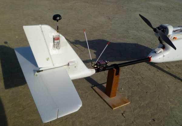 "The rear of the aircraft showing the 5.8 GHz video transmitter I embedded into the tail with some surface area exposed for cooling. The object with the V antennas is the long range 433 MHz UHF RC receiver. At the right edge of the picture is the motor turning a 12"" propeller above the speed controller."