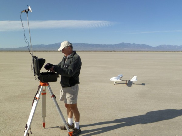 Me in the process of setting up the ground station, Skywalker in background. It's sort of hard to get a sense of its scale.