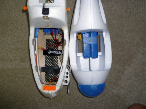 Looking down into the two payload pods. Both contain two 3,300 mAh 4S LiPo battery packs for comparison. Both packs are shoved as far rearward as possible to show remaining available payload capacity. Note the much larger capacity of the Skywalker.