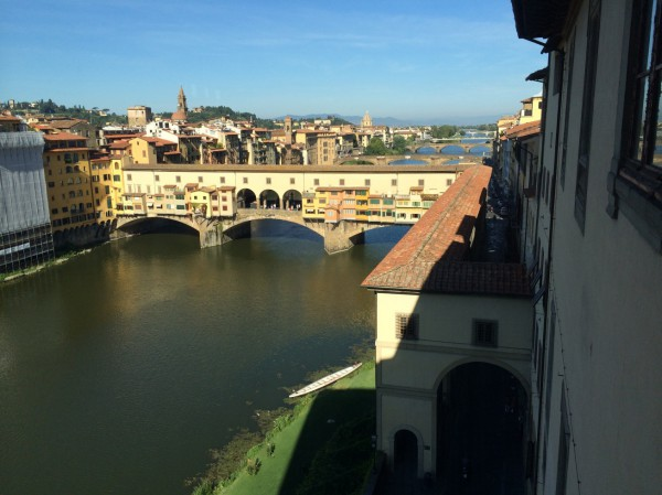 Looking out of the Uffizi at the Arno River and the Ponte Vecchio. The Vasari Corridor comes out of the Uffizi at the lower right and is the covered structure travelling to the bridge then turning right and crossing it.