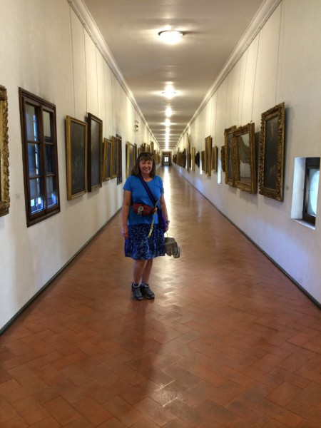 Some stray tourist (the only one that matters) in a very empty Vasari Corridor.