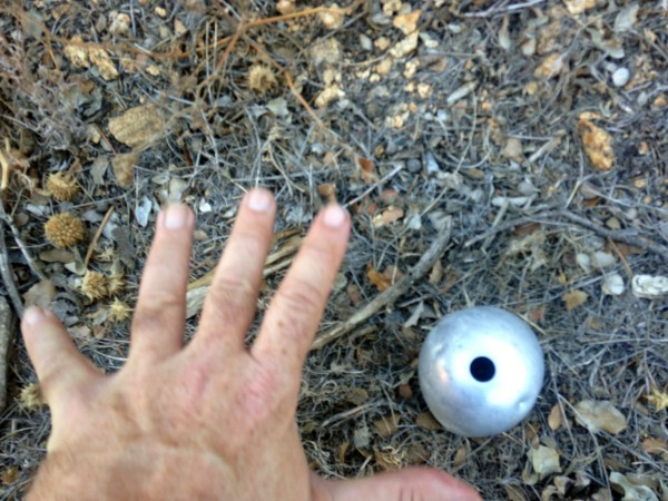 Another strange silver ball with a hand to provide scale.