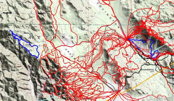 JT79 GPS tracks are shown in dark blue at the left and right. Tracks from the original search are shown in black and searches since then are shown in red. The light blue line is the 10.6 mile radius from the Serin Drive cell tower and the orange line is the 11.1 mile radius.