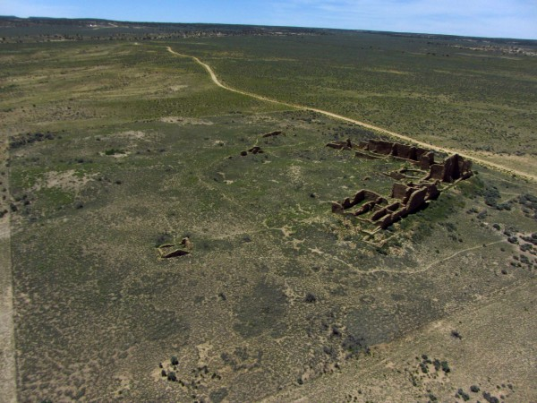 A very elevated view of Pueblo PIntado showing the entire site. The change in ground color marks the fence line up to which the Navajo animals graze.