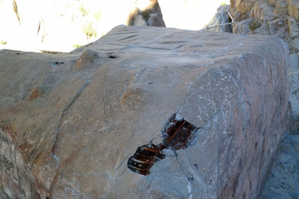 There were a few bit of damage that may have come from falling rocks. The water feed pipe is visible behind the faux boulder.