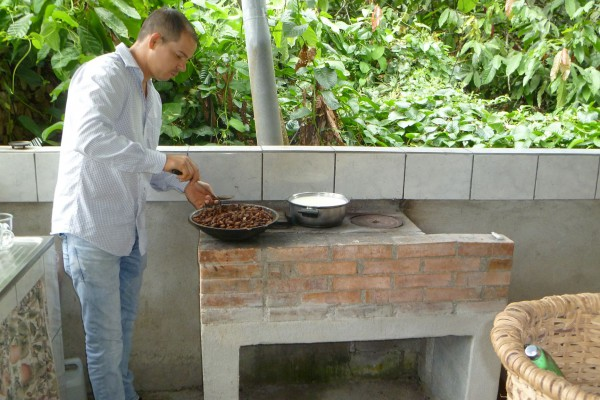 Roasting a pan of cocoa beans.