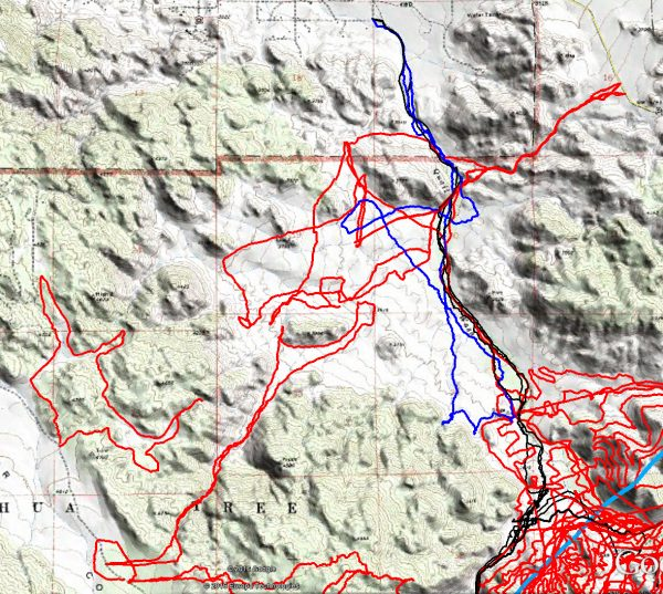 JT82 GPS tracks are shown in dark blue. Tracks from the original search are shown in black and searches since then are shown in red. The light blue line is the 10.6 mile radius from the Serin Drive cell tower.