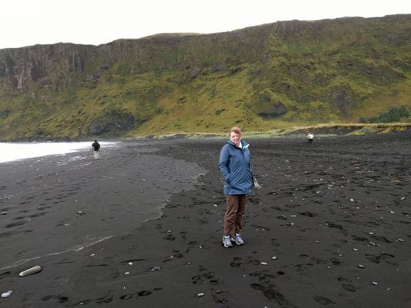 Black sand beach at Vik. She doesn't look happy because it's cold and windy. Welcome to Iceland!